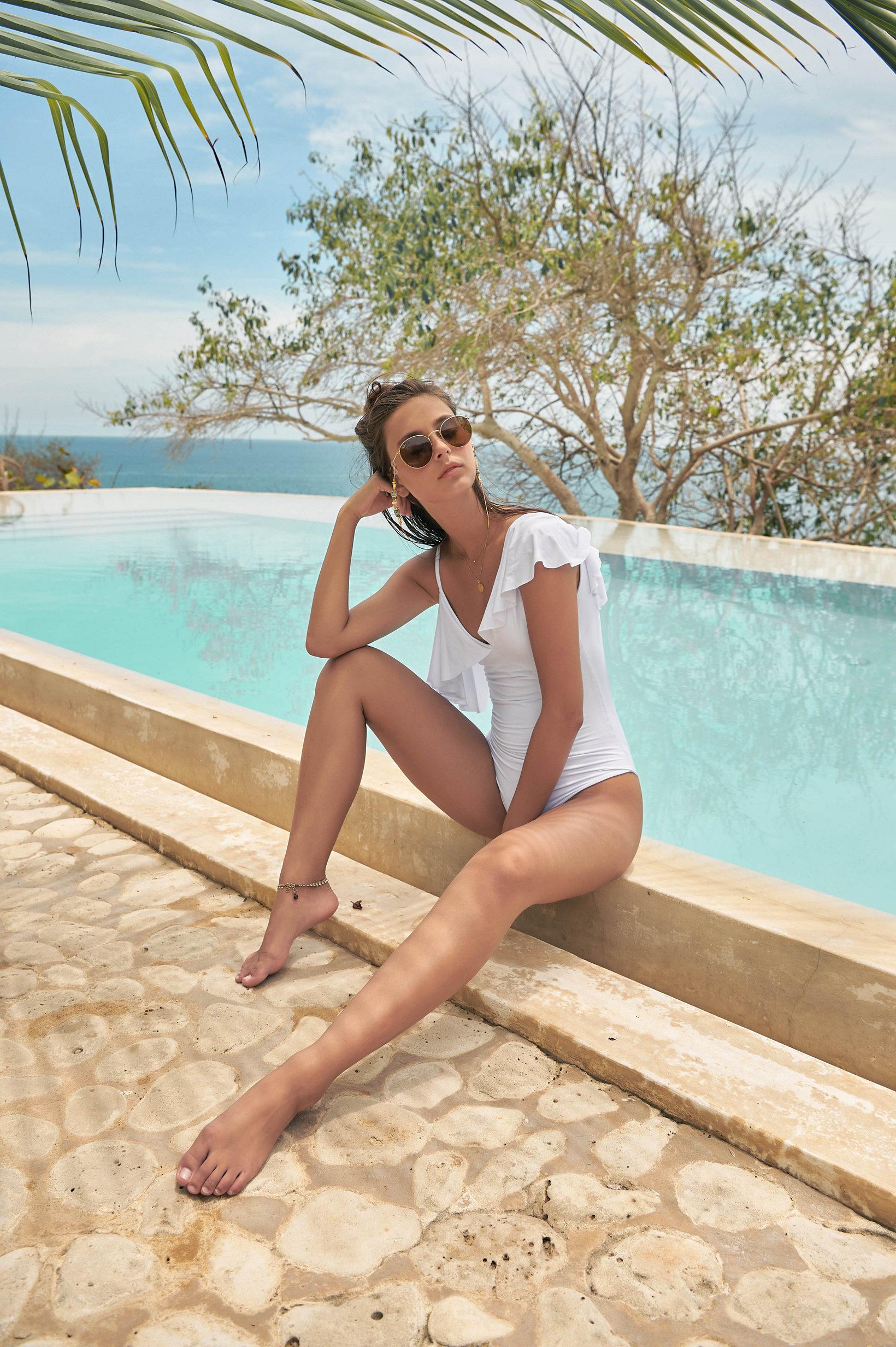 2019 Malai Swimwear at Butterflies and Bikinis featuring the Malai White Ruffle One Piece