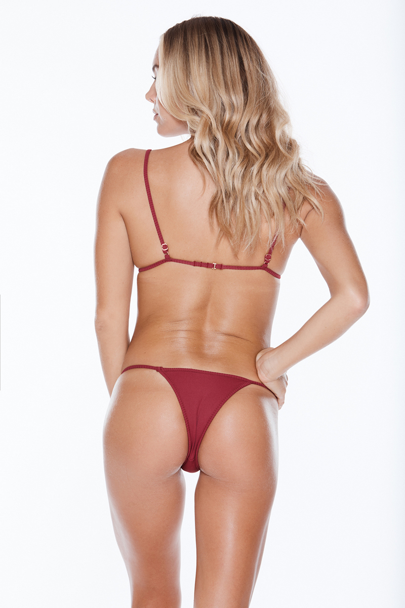 Find the 2019 MGS Swimwear Collection at Butterflies and Bikinis, featuring the MGS Swim Low Tide Top and Low Tide Bottom in Burgundy